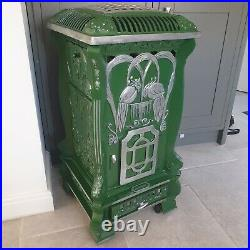 French Vintage green provence portable gas heater. La fontaine