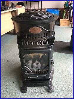 Provence gas heater with two empty gas cylinders